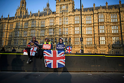 © Licensed to London News Pictures. 29/03/2019. London, UK. Brexit supporters are seen sitting on a security barrier outside the Houses of Parliament, after MPs rejected Theresa May's withdrawal agreement. Photo credit: Ben Cawthra/LNP