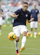 JACKSONVILLE, FL - JUNE 07:  Forward Clint Dempsey #8 of the United States shoots during pre-game warmups before the international friendly match against Nigeria at EverBank Field on June 7, 2014 in Jacksonville, Florida.  (Photo by Mike Zarrilli/Getty Images)