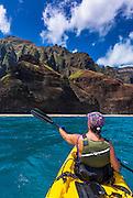 Sea kayaking along the Na Pali Coast, Island of Kauai, Hawaii USA