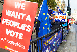"""One poster demands a """"People's Vote"""" referendum on Prime Minister Theresa May's Brexit deal, whilst another poster is emphatic that Leave Means Leave.  London, January 14 2019."""