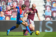 Sean Walsh (#4) of Inverness Caledonian Thistle FC tackles Liam Boyce (#10) of Heart of Midlothian FC during the SPFL Championship match between Heart of Midlothian and Inverness CT at Tynecastle Park, Edinburgh Scotland on 24 April 2021.