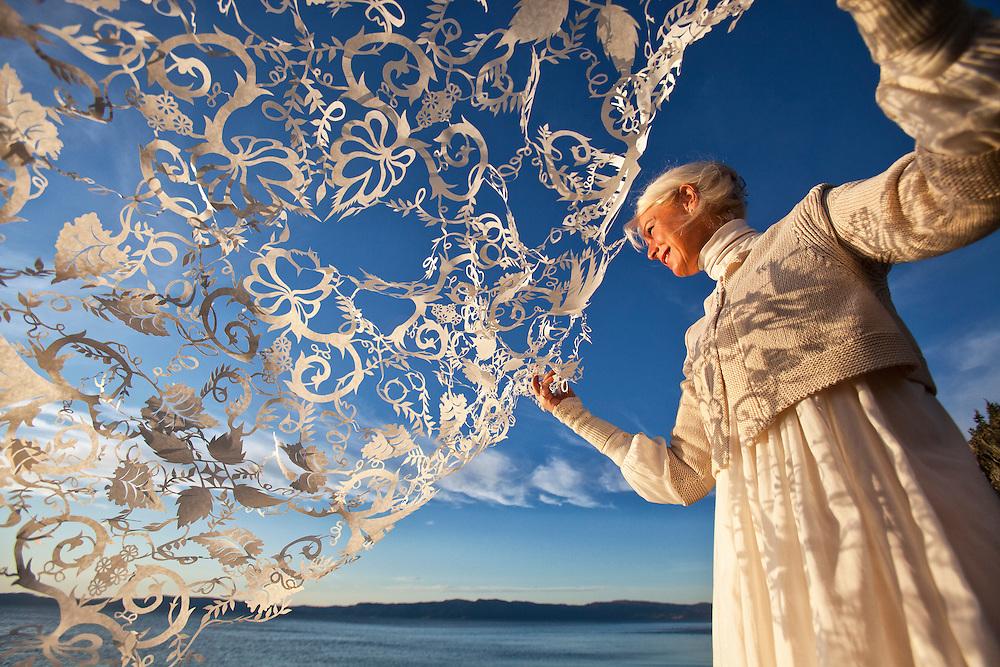 Trondheim, Norway.<br /> Papercut artist Karen Bit Vejle holds up one of her papercut works.