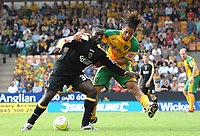 Photo: Ashley Pickering.<br /> Norwich City v Cardiff City. Coca Cola Championship. 01/09/2007.<br /> Jimmy-Floyd Hasselbaink of Cardiff (L) holds off Darel Russell of Norwich