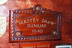 © Licensed to London News Pictures. 13/12/2013. Plaque on Massey Shaw marking her involvement in the Dunkirk evacuations, used with permission of the Massey Shaw Trust. The famous and historic fireboat MASSEY SHAW has returned to London today after a Heritage Lottery funded restoration. The fireboat was built in the 1930s and played a role in the war, helping to evactuate soldiers from Dunkirk and also dealing with fires from the river during the Blitz. The restoration of Massey Shaw was carried out in Gloucester after a lottery award in 2008. She is the oldest operating fireboat in Europe and is listed in the National Historic Fleet. She arrived at West India Dock this morning on a lorry where she was moved by crane in to the water. Video available here http://youtu.be/umLWqealesU Credit : Rob Powell/LNP