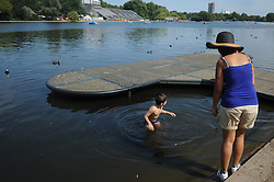 © Licensed to London News Pictures. 18/08/2012. London,UK. Children enjoying hot weather with water at Princess Diana Memorial Fountain in Hyde Park, London .  Photo credit : Thomas Campean/LNP
