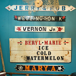 August 4, 2017 - Tangier Island, VA - Mementoes from Tangier Island's past populate the walls of the Tangier History Museum on the island. Here the nameplates of boats decorate the walls. <br /> Photo by Susana Raab/Institute