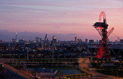 © Licensed to London News Pictures. 19/06/2014. London, UK. A sunset view of the ArcelorMittal Orbit an the City from Stratford, east London, the last day before the Summer solstice. Photo credit : Isabel Infantes / LNP