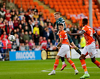 Football - 2021 / 2022 EFL Carabao Cup - Round One: Blackpool vs. Middlesbrough<br /> <br /> Josh Coburn of Middlesbrough climbs above Oliver Casey of Blackpool to get in his header on goal, at Bloomfield Road.<br /> <br /> COLORSPORT/ALAN MARTIN