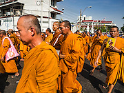 16 DECEMBER 2015 - BANGKOK, THAILAND:  Buddhist monks walk in the funeral procession for Somdet Phra Nyanasamvara, who headed Thailand's order of Buddhist monks for more than two decades and was known as the Supreme Patriarch. He died Oct. 24, 2013, at a hospital in Bangkok and was cremated today. He was 100. He was ordained as a Buddhist monk in 1933 and appointed as the Supreme Patriarch in 1989. He was the spiritual advisor to Bhumibol Adulyadej, the King of Thailand when the King served as a monk in 1956. Tens of thousands of people lined the streets during the procession to pray for the Patriarch.    PHOTO BY JACK KURTZ