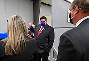 Illinois Governor J.B. Pritzker (center) asks questions of Myla Blandford, deputy director of the St. Clair County Health Department (left) and Mark Kern, St. Clair County Board Chairman, as he toured the mass vaccination site at the Belle-Clair Fairgrounds in Belleville, IL on February 18, 2021.<br /> Photo by Tim Vizer