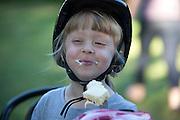 Polish girl wearing her new bicycle helmet enjoying birthday cake. Zawady Central Poland