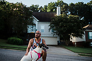 """BIRMINGHAM, AL – SEPTEMBER 4, 2020: Jonathan Perez, 31, walks his dog Meat Mountain through a neighborhood in Hoover.<br /> <br /> As the coronavirus pandemic continues to grow in the United States, the cost of recovery from Covid-19 has varied considerably for Americans. Jonathan Perez, 31, contracted Covid-19 and was admitted to a nearby hospital in Birmingham, where his condition quickly worsened. """"They didn't think I'd make it,"""" Perez said. """"I'd said my peace."""" Fortunately Perez recovered, but he'd incurred medical bills in excess of $50,000. The uninsured Marine veteran was told his entire bill would be covered by the hospital using funds from the CARES Act. In the end, he ended up paying around $800. Perez, who has been virus-free for about a month, still suffers from fatigue. He spends his time trying to recover full use of his lungs by walking his dogs several times a day. """"I'm just thankful to be here,"""" he told me."""