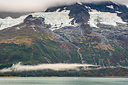 Melt water cascades down Mount Gilbert from Serpentine Glacier in Barry Arm in Harriman Fjord, near Whittier, Alaska. The glacier has retreaded dramatically from a tidewater glacier to becoming a hanging glacier.