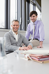 Portrait of businessmen in office, smiling