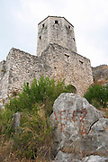 View of the tower fortress, graffiti on a stone 'Velez R A'. Pocitelj historic Muslim and Christian village near Mostar. Federation Bosne i Hercegovine. Bosnia Herzegovina, Europe.