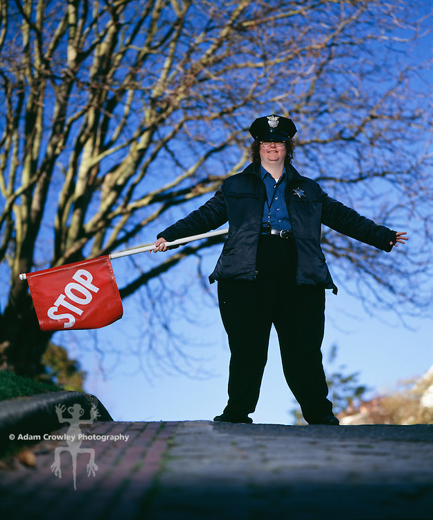 Traffic police woman holding up stop sign, portrait