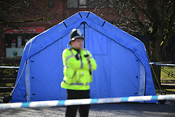 © Licensed to London News Pictures. 06/03/2018. Salisbury, UK. A police officer stands  in front of a blue police tent at the scene near the Maltings shopping centre in Salisbury where former Russian spy Sergei Skripal and a woman in her 30s were taken ill with suspected poisoning. The couple where found unconscious on bench in Salisbury shopping centre. Specialist units have been called in to deal with any possible contamination. Photo credit: Ben Cawthra/LNP