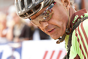 William Simpson encourages his team-mate Mike Nixon (seen in reflection of glasses) during stage 6 of the 2011 Absa Cape Epic Mountain Bike stage race held in and around Oak Valley on the 2nd April 2011..Photo by Greg Beadle/Cape Epic/SPORTZPICS