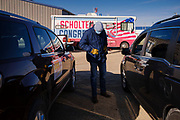 """01 NOVEMBER 2020 - CHARLES CITY, IOWA: Congressional candidate J.D. SCHOLTEN talks to voters in their cars during a drive in rally in Charles City, a community in northern Iowa. Scholten, a Democrat from Sioux City, Iowa, is running against Randy Feenstra, a Republican, in the 2020 general election on November 3. Iowa's 4th district, centered in the agricultural and sparsely populated northwest corner of the state, is the largest congressional district in Iowa and encompasses about ⅓ of the state of Iowa. Because of the COVID-19 pandemic Scholten has transitioned to drive rallies rather than in person. Scholten is on his """"Every Town Tour 2020."""" He is visiting all 375 towns in the 39 counties in the district.         PHOTO BY JACK KURTZ"""