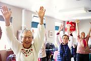senior asian women exercise class