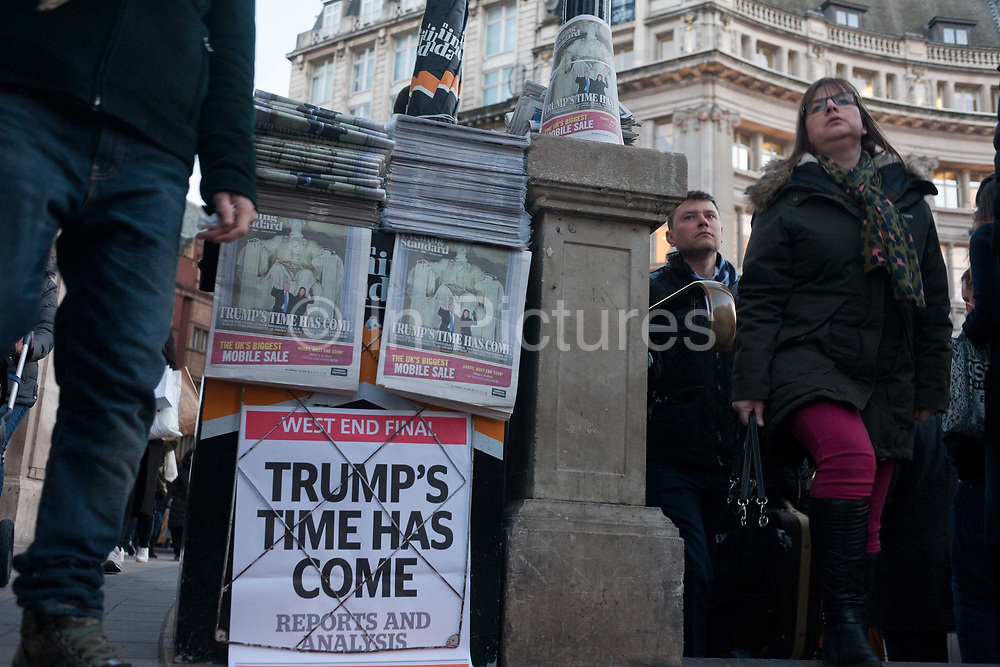 London Evening Standard newspapers feature the headline about Donald Trumps inauguration, on the day of he was made 45th US president, on 20th January, outside Charing Cross station, London borough of Westminster, England. The copies show his face and that of his wife, Melania Trump.