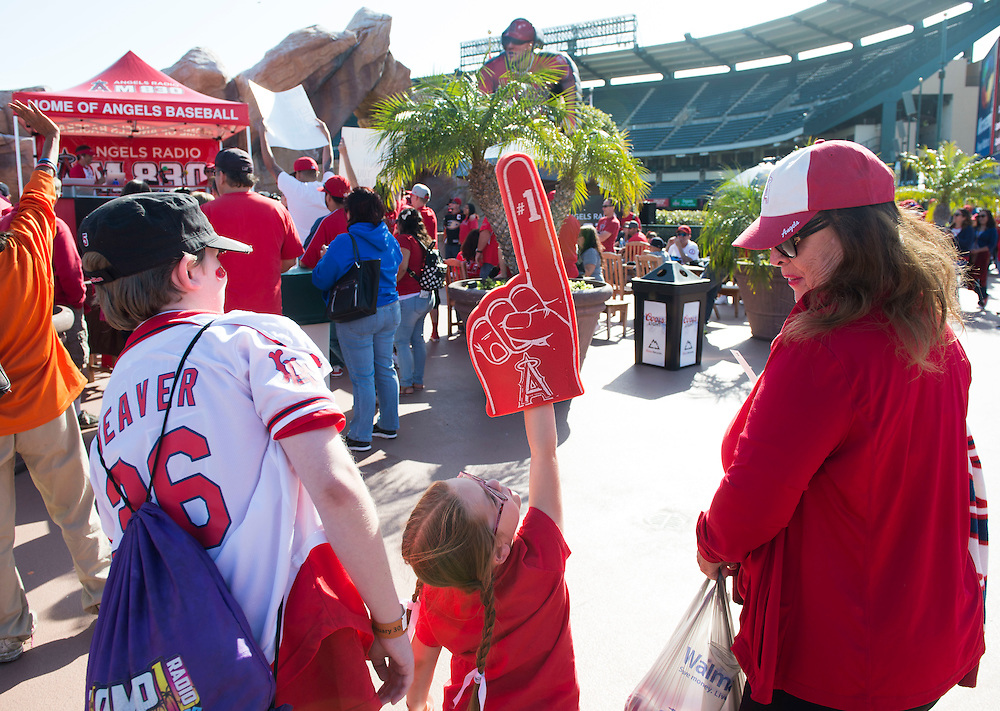 Nicole Daigle, 6, of Long Beach, center, points her foam finger to the sky between brother Noah, 14, and grandma Terri Fontenot, of  Huntington Beach during the Angels' Halo Honk event Wednesday at Angel Stadium.<br /> <br /> ///ADDITIONAL INFO:   <br /> <br /> angels.0428.kjs  ---  Photo by KEVIN SULLIVAN / Orange County Register  --  4/27/16<br /> <br /> The Los Angeles Angels take on the Kansas City Royals Wednesday at Angel Stadium.<br /> <br /> <br />  4/27/16