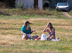 """© Licensed to London News Pictures. 13/09/2020. London, UK. Picnickers enjoy the sunshine on Wimbledon Common in South West London this afternoon a day before the """"Rule of 6"""" comes into force on Monday as weather experts announce a 5 day mini-heatwave in the South East of England this week with highs of 29c. Prime Minister Boris Johnson announced on Friday that gatherings of more than six people will be banned from Monday (tomorrow) in the hope of reducing the coronavirus R number. The Rule of Six as it is known, has already become unpopular with MPs and large families for being too strict. Photo credit: Alex Lentati/LNP"""