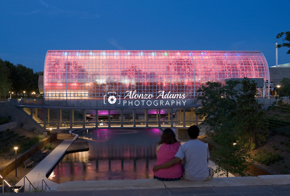 A couple sits watching the lights on the Myriad Botanical Gardens and Crystal Bridge Tropical Conservatory in downtown Oklahoma City, Okla. at dusk on Saturday, June 4, 2011.  (Photo by Alonzo J. Adams)