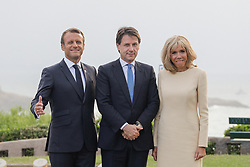 French President Emmanuel Macron and his wife Brigitte welcome Italian Premier Giuseppe Conte at the Biarritz lighthouse, southwestern France, ahead of a working dinner on August 24, 2019, on the first day of the annual G7 Summit. Photo by Thibaud Moritz/ABACAPRESS.COM