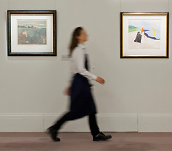 © Licensed to London News Pictures. 13/09/2013. London, UK. A Sotheby's employee walks past 'Evening, Melancholy I' (L) (1896) (est. GB£550,000-750,000) and 'Two Women on the Shore' (1898) (est. GB£400,000-500,000), both rare woodcuts by Edvard Munch, at the press view for Sotheby's 'Prints and Multiples Sale' on New Bond Street in London today (13/09/2013). The auction, set to take place on the 17th of September, includes works by Munch, Rembrandt, Basquiat, Warhol and Picasso. Photo credit: Matt Cetti-Roberts/LNP