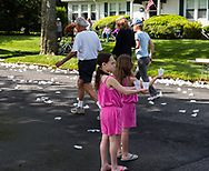 Spring Lake, NJ -- May 27, 2017.  Two girls helping out a the race by handing water to the racers. editorial use only.