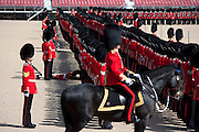 """Mcc0023074 . Daily Telegraph..A Grenadier Guardsman """"piles in"""" whist rehearsing on Horseguards for Trooping the Colour in celebration of the Queen's Birthday on June 12 ..The Grenadier Guards only recently finished a six month tour of Helmand , Afghanistan on March 31...London 19 June 2010......Not AP.Not Reuters.Not PA.Not Getty.Not AFP."""