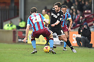 Will Grigg of Wigan Athletic and Jamie Ness of Scunthorpe United fight for ball  during the Sky Bet League 1 match between Scunthorpe United and Wigan Athletic at Glanford Park, Scunthorpe, England on 2 January 2016. Photo by Ian Lyall.