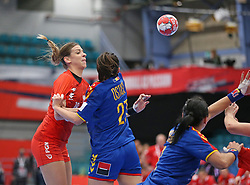 KOLDING, DENMARK - DECEMBER 5: Aleksandra Zych is held by Lorena Ostase during the EHF Euro 2020 Group D match between Poland and Romania in Sydbank Arena, Kolding, Denmark on December 5, 2020. Photo Credit: Allan Jensen/EVENTMEDIA.
