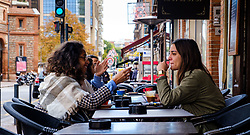 Girls chatting in a cafe in the Place Dupuy, Toulouse, France<br /> <br /> (c) Andrew Wilson | Edinburgh Elite media