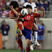 Kelley O'Hara, USA, challenges Yoo Younga, Korea Republic, in action during the U.S. Women Vs Korea Republic friendly soccer match at Red Bull Arena, Harrison, New Jersey. USA. 20th June 2013. Photo Tim Clayton
