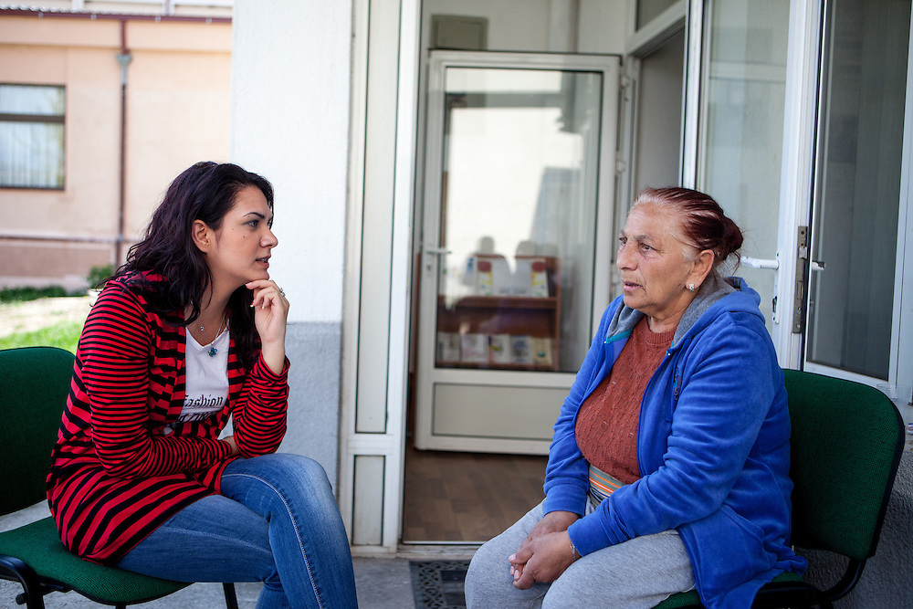 NGO Kham client Sazije Fazlievik  at the office of the organisation in the city of Delcevo, Macedonia. Mrs. Sazije is talking to Sanela Abdulova, another paralegal working for NGO KHAM.