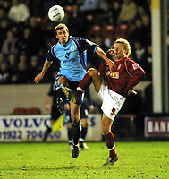 Photo: Dave Linney.<br />Walsall v Barnsley. The FA Cup. 17/01/2006.<br />Barnsley's Richard Kell (L) heads clear before Mads Timm can reach the ball.