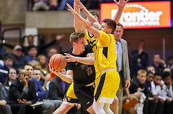 Mar 20, 2019; Morgantown, WV, USA; Grand Canyon Antelopes guard Trey Drechsel (2) dribbles while guarded by West Virginia Mountaineers guard Jordan McCabe (5) during the second half at WVU Coliseum. Mandatory Credit: Ben Queen