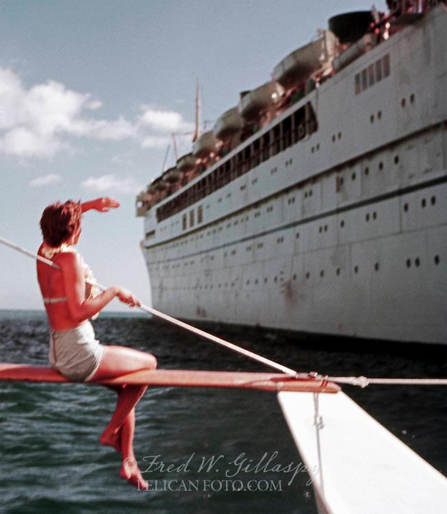Bidding a fond farewell and Aloha to Matson Lines' S.S. Lurline in Honolulu Harbor, 1959.
