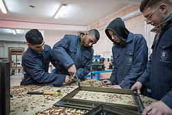 25 February 2020, Jerusalem: Students (left to right) Mohammad, Mohammad, Majd and Sami work on building a window frame, during class in Aluminium work at the vocational training centre in Beit Hanina. The Lutheran World Federation's vocational training centre in Beit Hanina offers vocational training for Palestinian youth across a range of different professions, providing them with the tools needed to improve their chances of finding work.