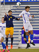University of Missouri - Kansas City player Gustavo Leal Murtha (left) and St. Louis University forward Simon Becher (15) leap for a header. University of Missouri - Kansas City played SLU in men's soccer on February 3, 2021 at Robert Hermann Stadium on the SLU campus in St. Louis, MO.<br />Tim Vizer/For the Post-Dispatch