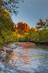 Half moon over Castle Rock and Oak Creek in Sedona Arizona