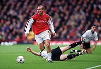 Fredrik Ljungberg (Arsenal) Chris Riggott (Derby County). Arsenal 0:0 Derby County, F.A.Carling Premiership, 11/11/2000. Credit / Colorsport / Stuart MacFarlane.