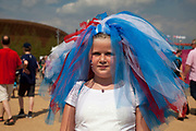 London, UK. Thursday 9th August 2012. London 2012 Olympic Games Park in Stratford. Young girl with a bridal head dress made from red white and blue material