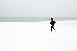 © under license to London News Pictures.  01/12/2010 A woman exercises in the snow running along Worthing Beach. Picture credit should read: Julie Edwards/London News Pictures