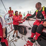 Leg 02, Lisbon to Cape Town, day 08, on board MAPFRE, Juan  Vila repartiendo su regalo de cumpleaños. Photo by Ugo Fonolla/Volvo Ocean Race. 12 November, 2017