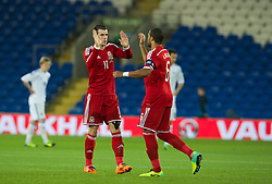 CARDIFF, WALES - Saturday, November 16, 2013: Wales' Gareth Bale and captain Ashley Williams in action against Finland during the International Friendly match at the Cardiff City Stadium. (Pic by David Rawcliffe/Propaganda)