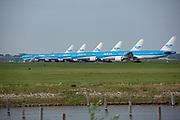 KLM 777 airplanes lined up on the Aalsmeerbaan runway at Schiphol Airport. Lockdown