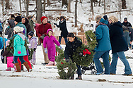 Goshen, New York - People place wreaths at graves during a Wreaths Across America ceremony at Orange County Veterans Memorial Cemetery on Dec. 16, 2017. About 3,000 wreaths were placed at graves, and small American flags were added to the wreaths at veterans' graves.